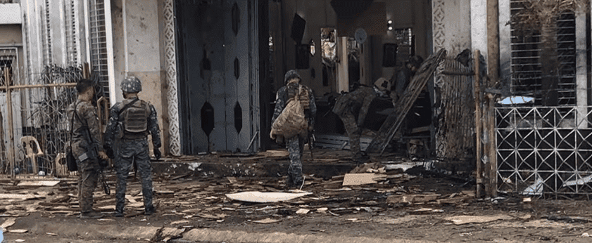 Troops walking into the destroyed cathedral - Al Jazeera English
