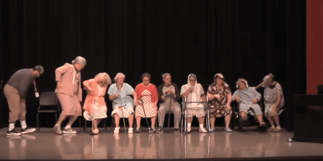 A line of grandmas and one grandpa entering the stage. | Photo: YouTube/Scott Reece