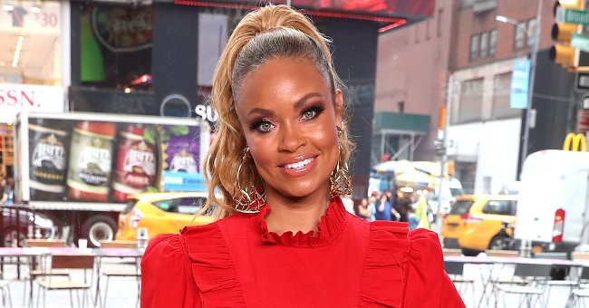 RHOP Star Gizelle Bryant Stuns in IG Snap as She Strikes a Pose in a $430 Newspaper-Print Top