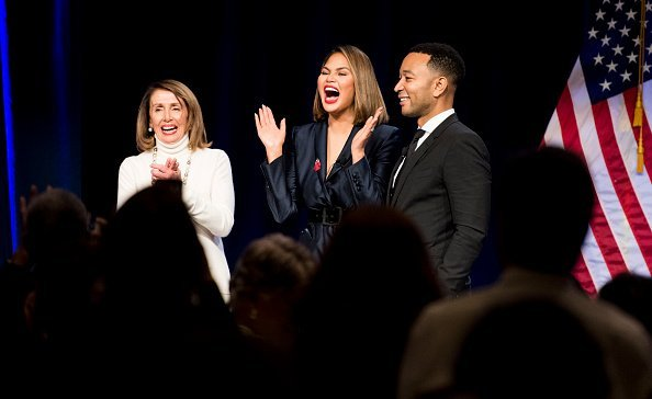 Speaker of the House Nancy Pelosi,  Chrissy Teigen and John Legend on stage | Photo: Getty Images