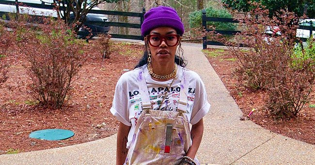 Teyana Taylor Looks Awesome Rocking a Stylish White Jumpsuit Covered in Paint & a Purple Hat