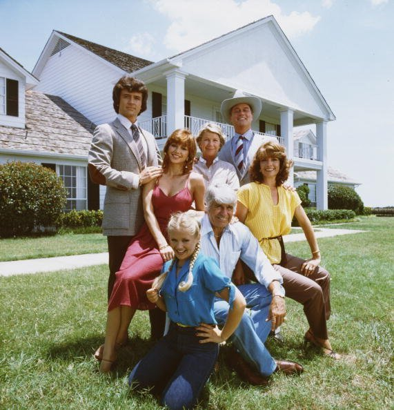 A promotional still from the American television series 'Dallas' shows members of the Ewing family as they pose in front of their television home, the Southfork Ranch, Dallas, Texas, 1979. | Photo: Getty Images