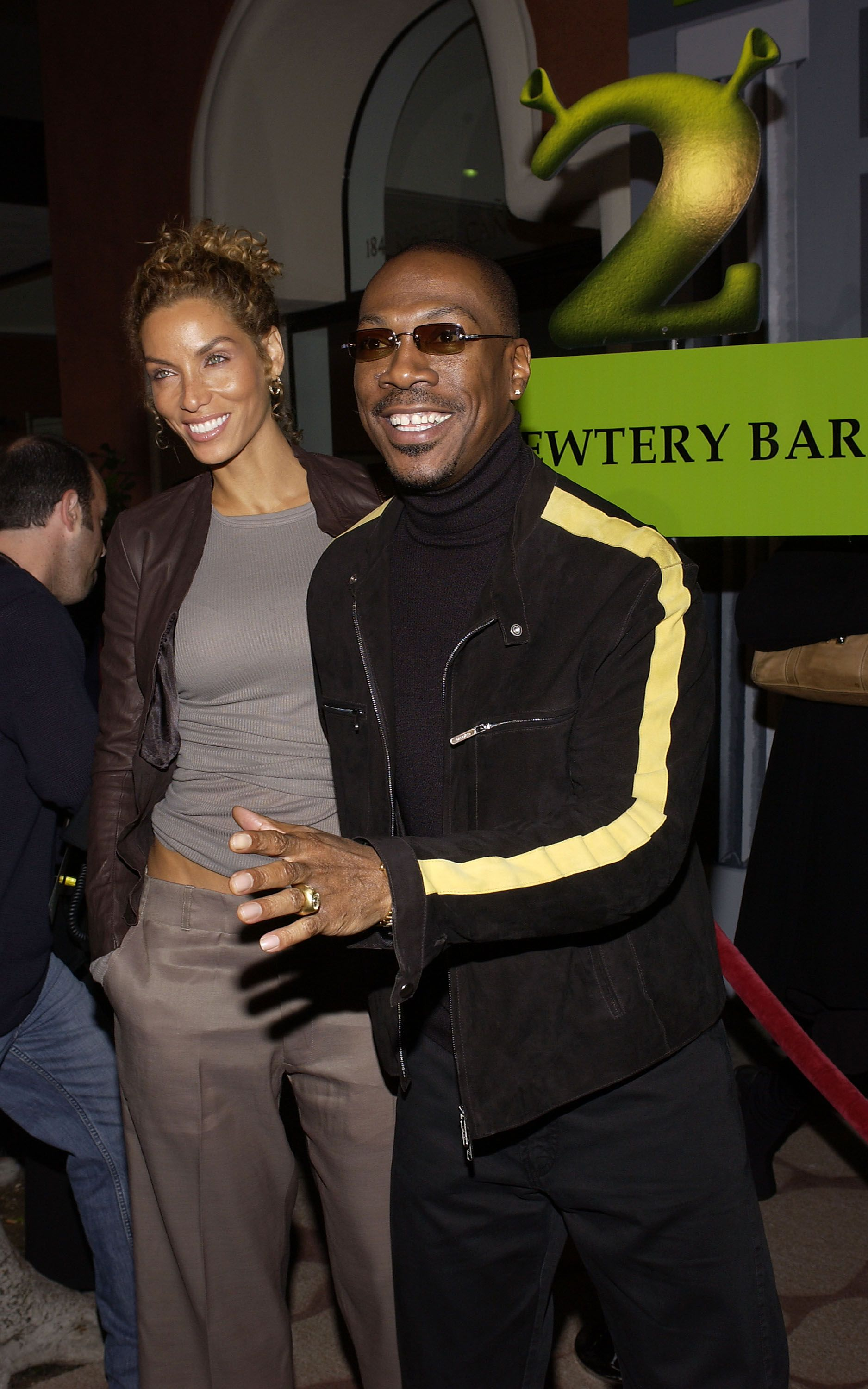 "Nicole and Eddie Murphy at the DVD release party of ""Shrek 2"" in November 2004. 