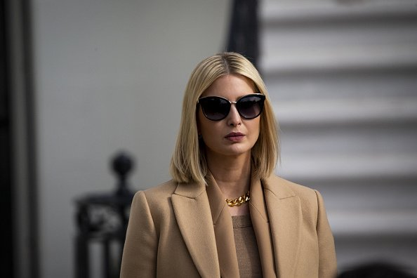 Ivanka Trump, senior adviser to U.S. President Donald Trump, listens as President Donald Trump, not pictured, speaks to members of the media before boarding Marine One on the South Lawn of the White House in Washington, D.C., U.S., on Wednesday, Nov. 20, 2019 | Photo: Getty Images