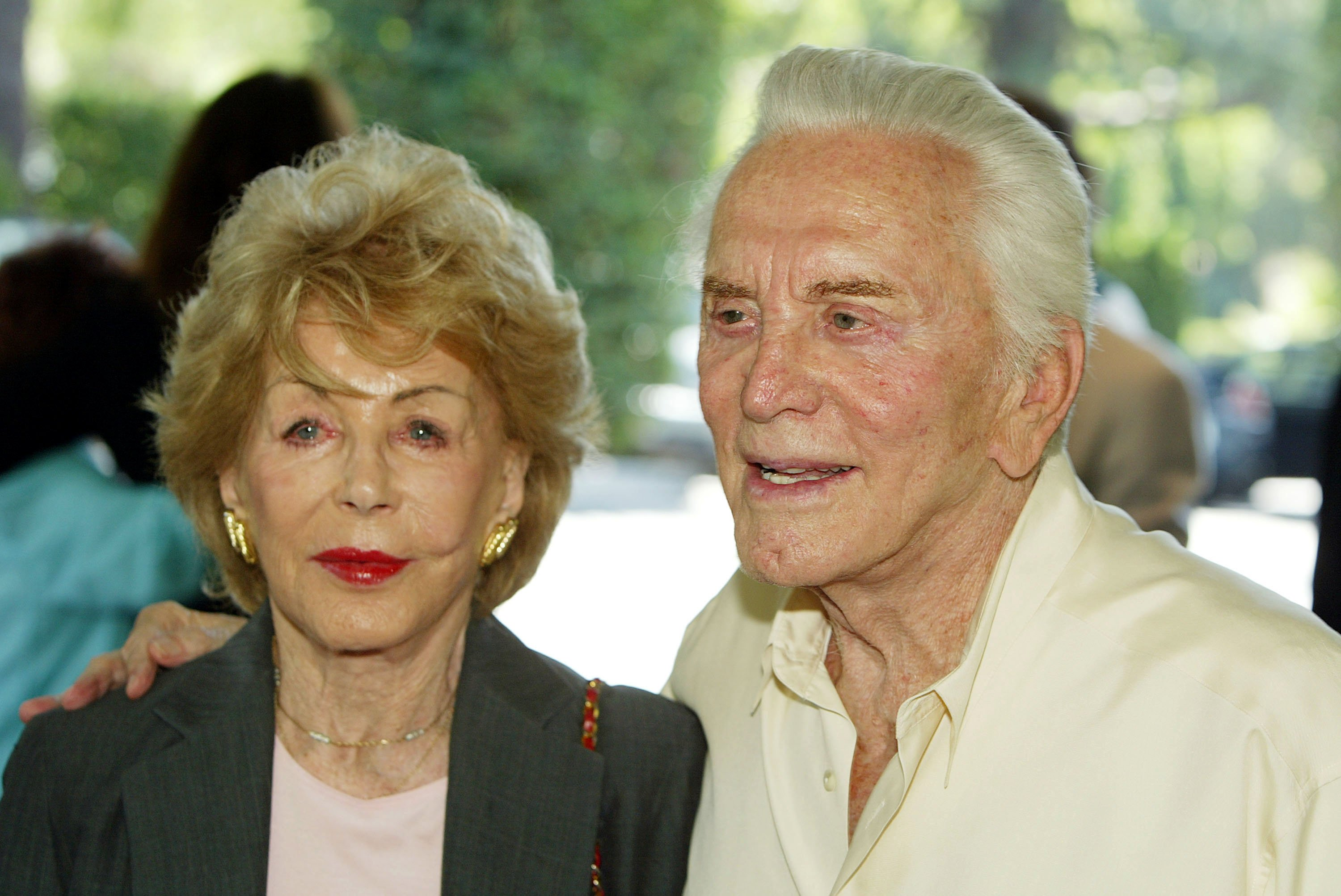 Actor Kirk Douglas (right) and his wife Anne arrive at the annual Hollywood Foreign Press Association installation luncheon on August 11, 2004, at the Beverly Hills Hotel, in Beverly Hills, California. | Source: Getty Images.