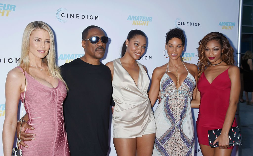 """Paige Butcher, Eddie Murphy, Bria Murphy, Nicole Murphy, and Shayne Murphy arrive at the premiere for """"Amateur Night"""" on July 25, 2016, in Hollywood, California 