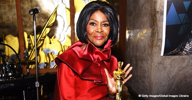 Cicely Tyson, 93, defies her age in structured red dress while posing with her honorary Oscar