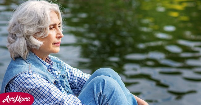 Mysterious lady by the lake | Source: Shutterstock
