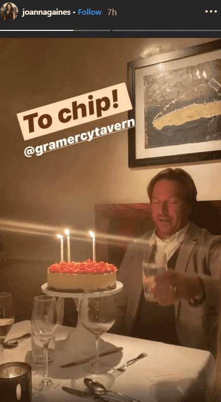 Chip Gaines smiles in front of a red berry topped cheese cake for his 45th birthday dinner celebration | Source: Instagram.com/joannagaines