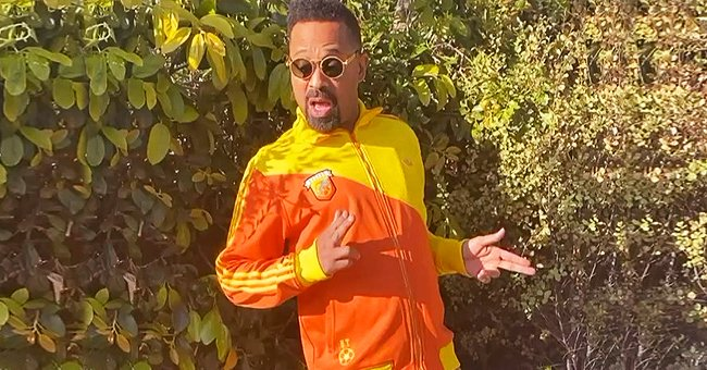 Mike Epps Dances Outdoor in Bright Multi-Colored Clothes and Sunglasses in a Recent Video