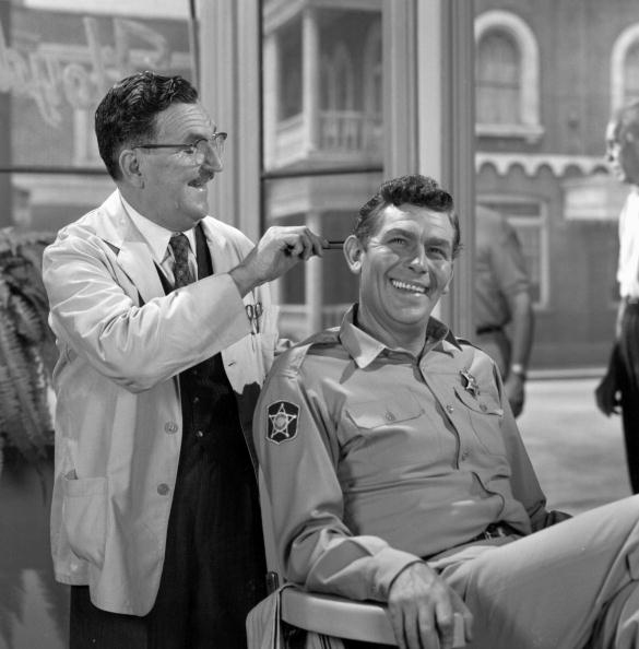 "Andy Griffith as Sheriff Andy Taylor and Howard McNear as barber Floyd Lawson in a scene from the television series ""The Andy Griffith Show,"" circa 1965. 