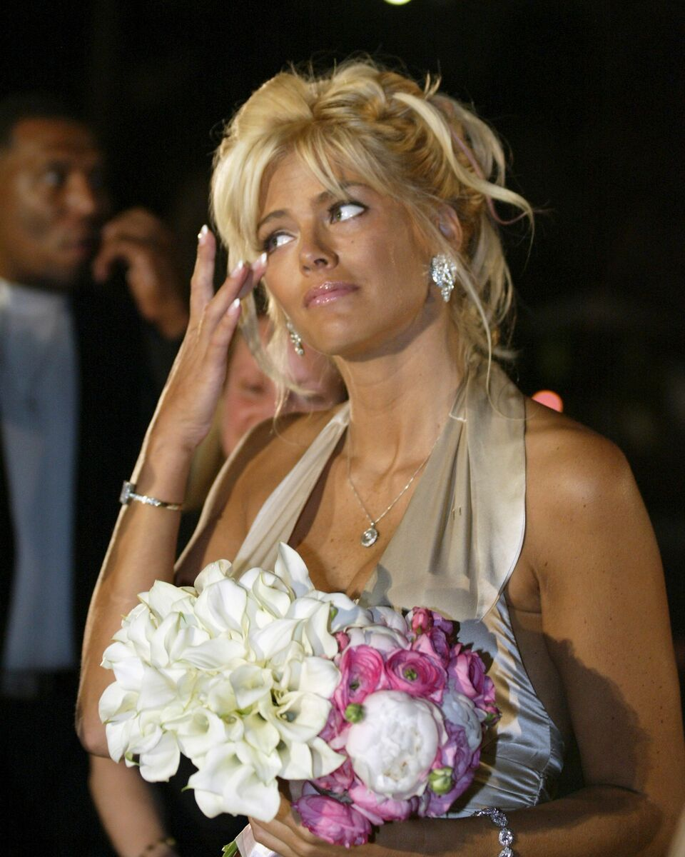 Anna Nicole Smith cries tears of joy as the Maid of Honor for Penny and Joseph Genovese as they renew their wedding vows. | Source: Getty Images
