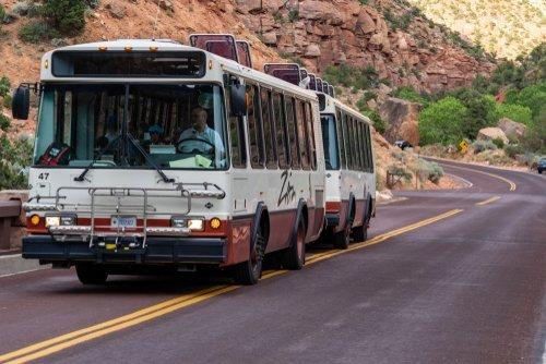 Two shuttle buses en route to their destination. | Source: Shutterstock.