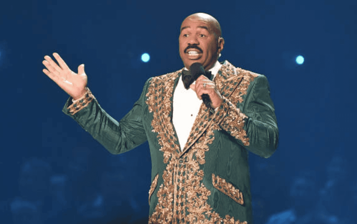 Steve Harvey speaks onstage while hosting the 2019 Miss Universe Pageant, at Tyler Perry Studios, on December 08, 2019 in Atlanta, Georgia | Source: Paras Griffin/Getty Images