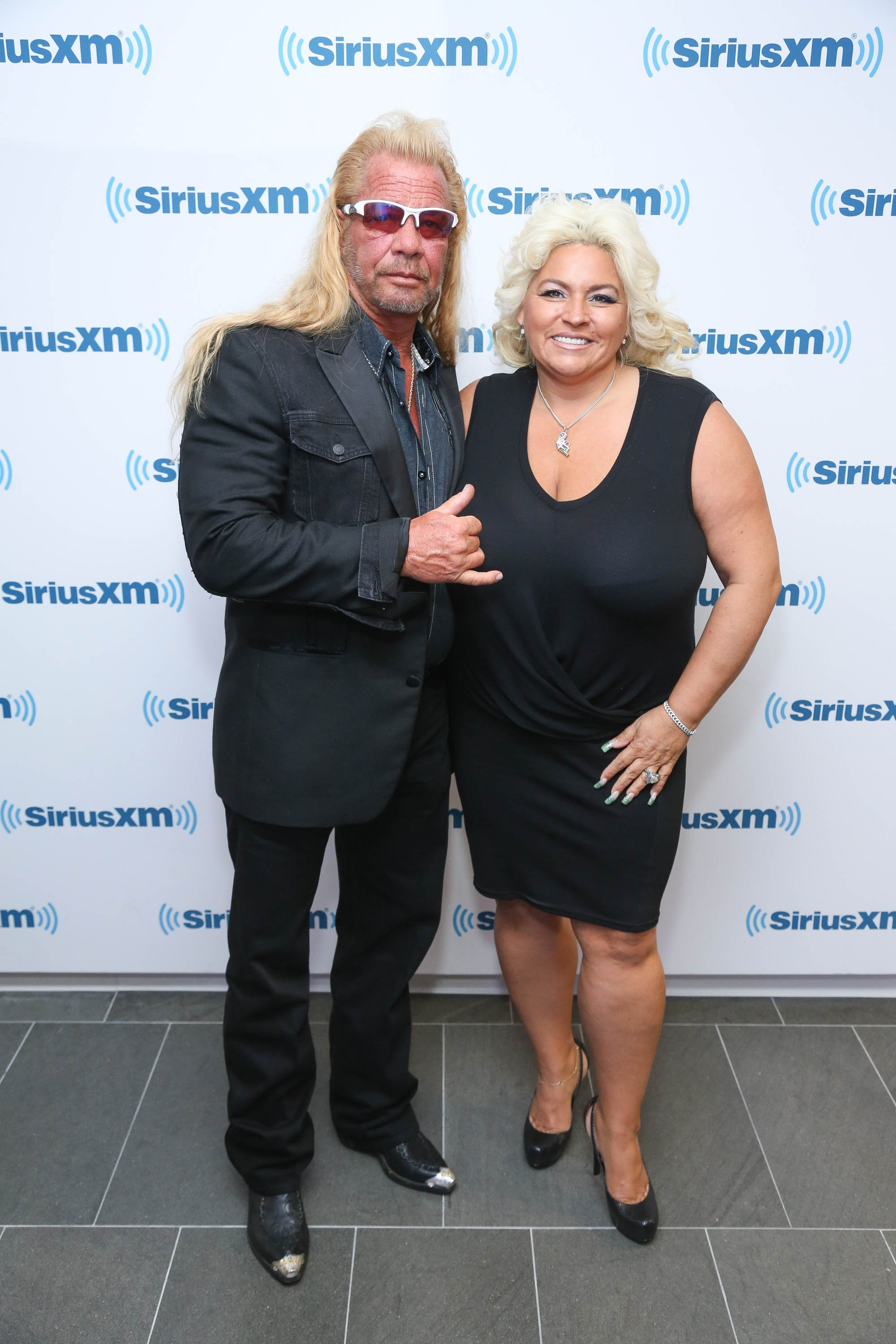 Dog the Bounty Hunter, Duane Chapman and wife Beth Chapman visit at SiriusXM Studios on June 9, 2014, in New York City. | Source: Getty Images.