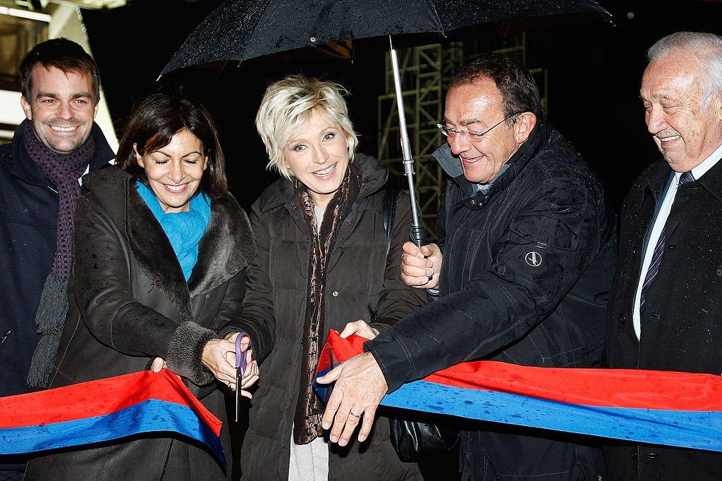 Évelyne Dhéliat and Jean-Pierre Pernaut. l Source: Getty Images