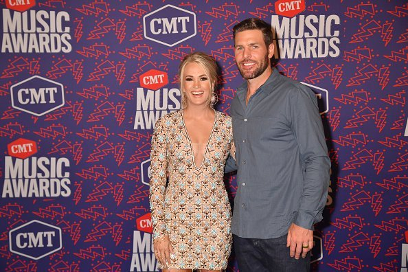 Carrie Underwood and Mike Fisher at the 2019 CMT Music Awards on June 05, 2019 | Photo: Getty Images