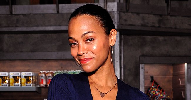 Zoe Saldana of 'Avatar' Fame Stuns in White Outfit with Sheer Sleeves and Ponytail in Stunning Photo