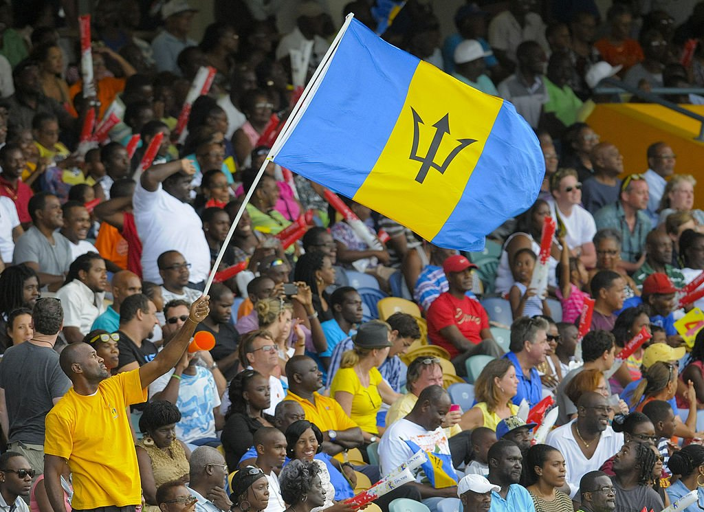 Fans wave the Barbados flag during a match between Barbados Tridents and Antigua Hawksbills at Kensington Oval on July 25, 2014 in Bridgetown, Barbados. | Photo: Getty Images.