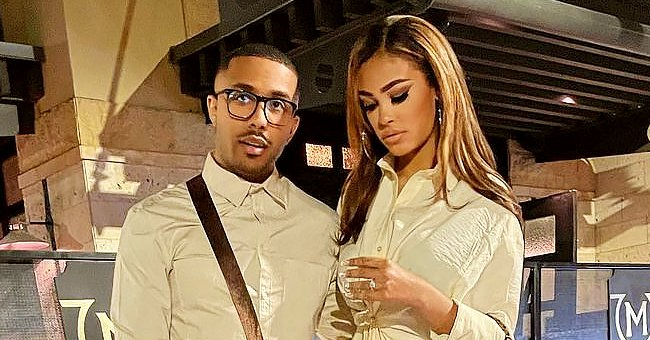 Marques Houston' Wife Miya Chose to Wear a Belted Cotton Dress & LV Handbag for Their Date
