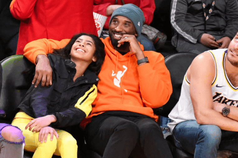 Kobe Bryant hugs daughter Gianna Bryant as they watch a basketball game between the Los Angeles Lakers and the Dallas Mavericks, at Staples Center, on December 29, 2019, in Los Angeles, California | Source: Allen Berezovsky/Getty Images
