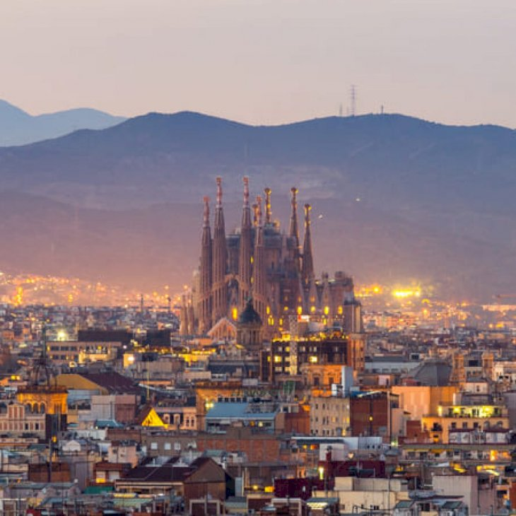 Aerial Panorama view of Barcelona city skyline and Sagrada Familia at dusk time, Spain   Shutterstock