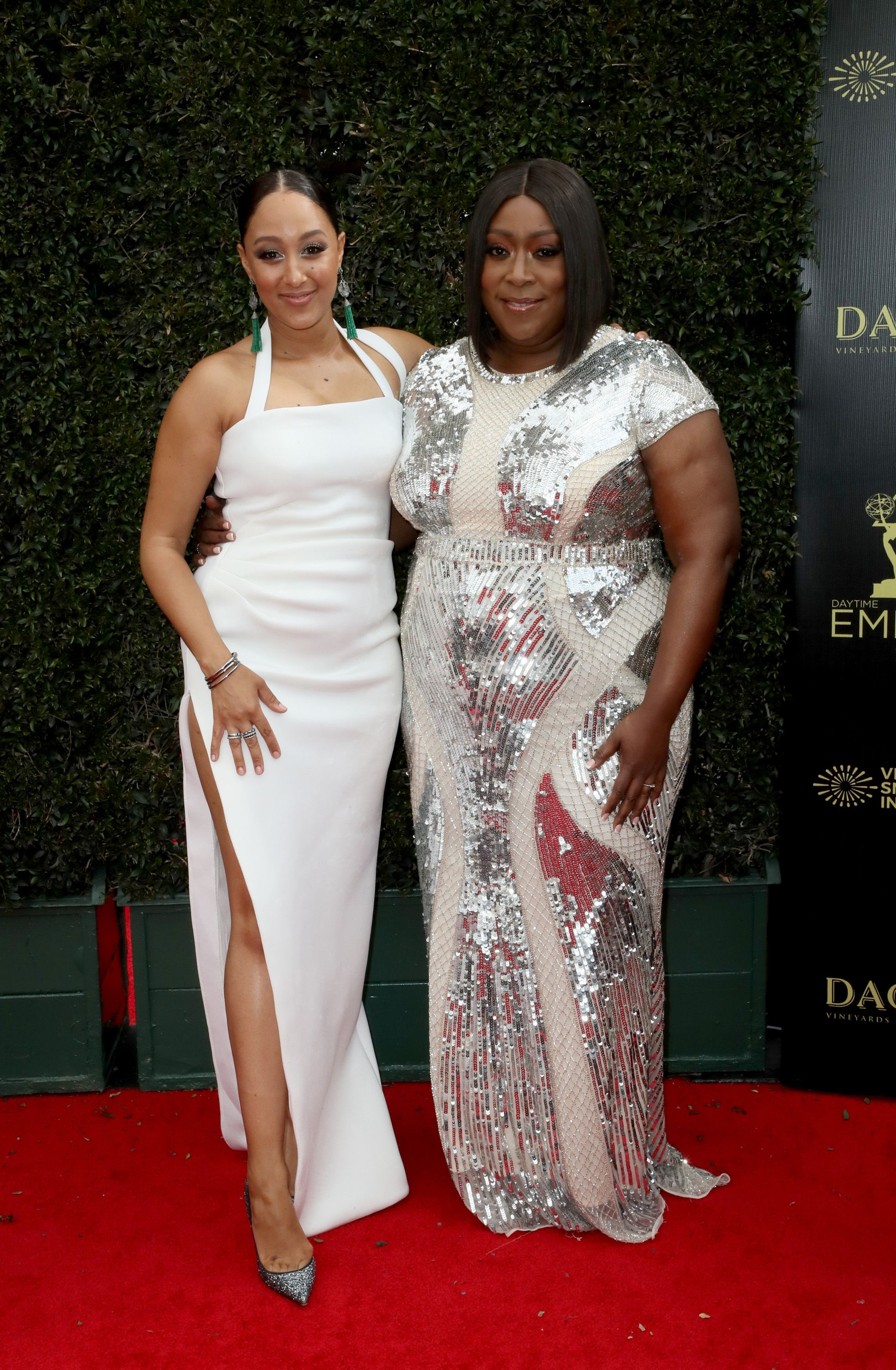 "Loni Love and ""The Real"" co-host Tamera Mowry at the 2019 Emmy Daytime Awards/ Source: Getty Images"