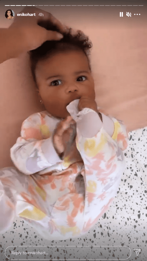 A picture of Kevin Hart's daughter Kaori lying down and wearing her beautiful onesie. | Photo: Instagram.com/Enikohart