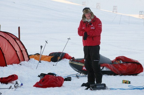 Prince Harry takes down his tent as he joins the Walking with the Wounded team on the island of Spitsbergen, for training before they start their charity trek to the North Pole, on March 31, 2011, in Spitsbergen, Norway. | Source: Getty Images.