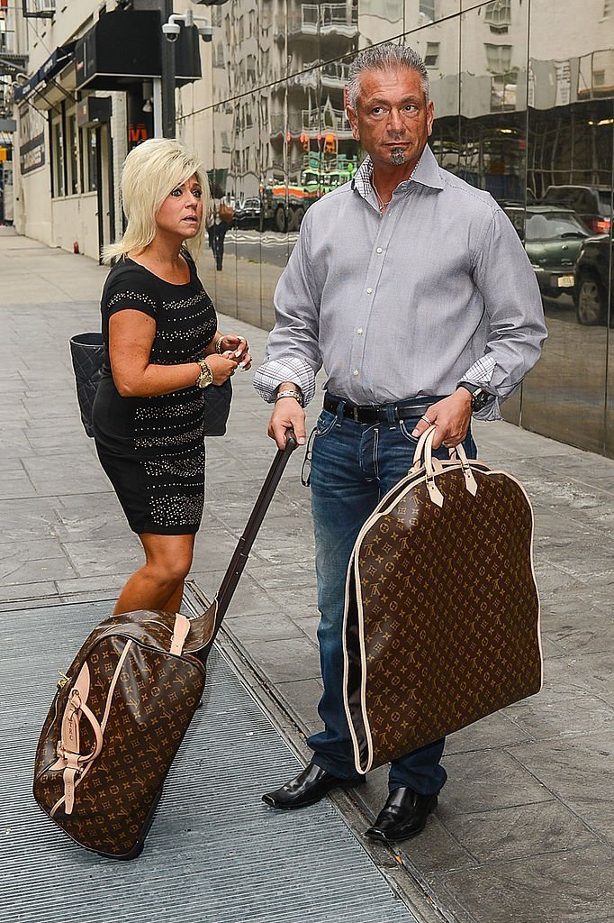 """TV personalities Theresa Caputo (L) and Larry Caputo leave the """"Good Day New York"""" taping at the Fox 5 Studios 