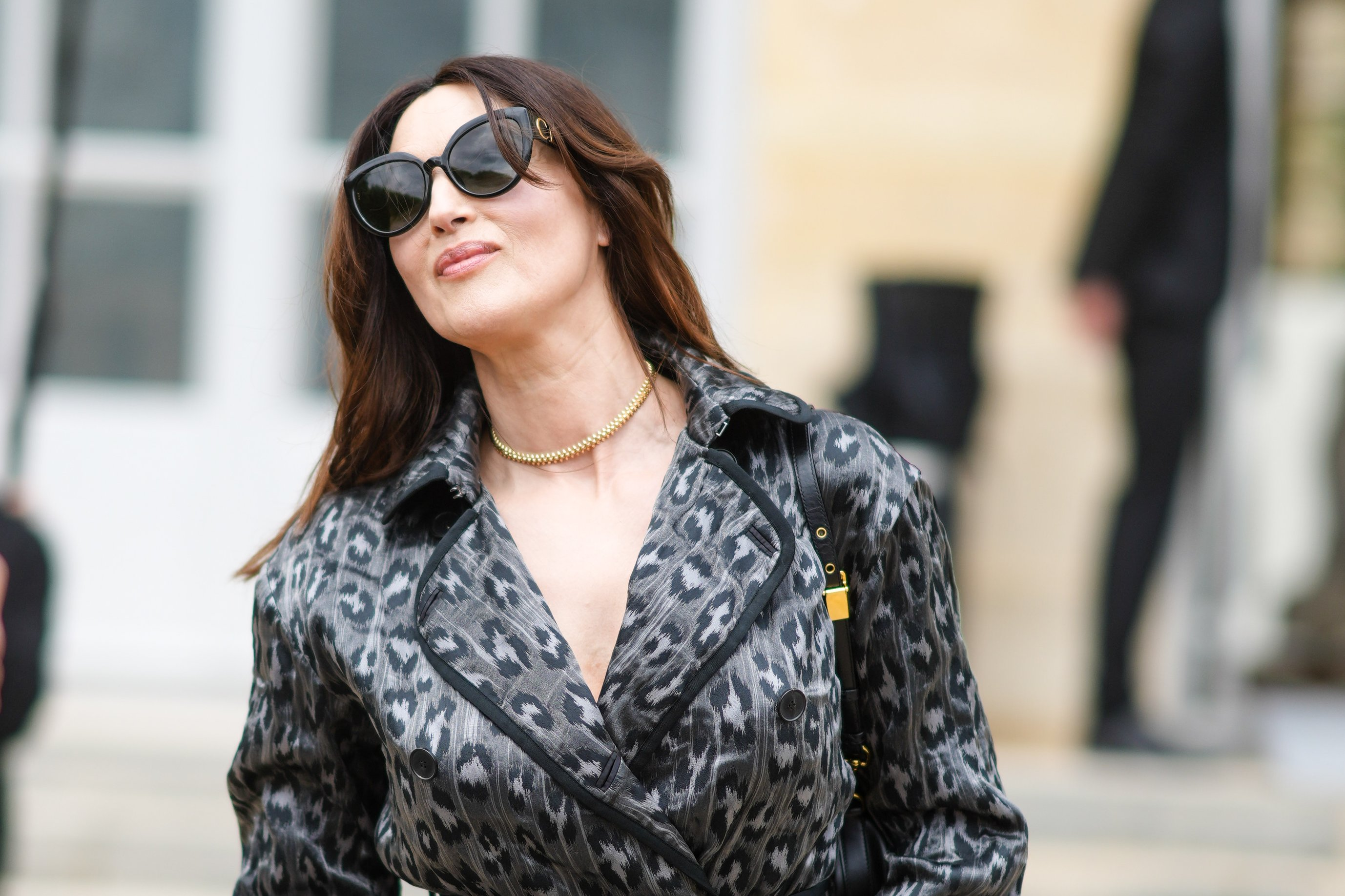 Monica Bellucci wears a trench coat with printed cheetah patterns, outside Dior, during Paris Fashion Week - Haute Couture Fall/Winter 2021/2022, on July 05, 2021 in Paris, France.| Source: Getty Images