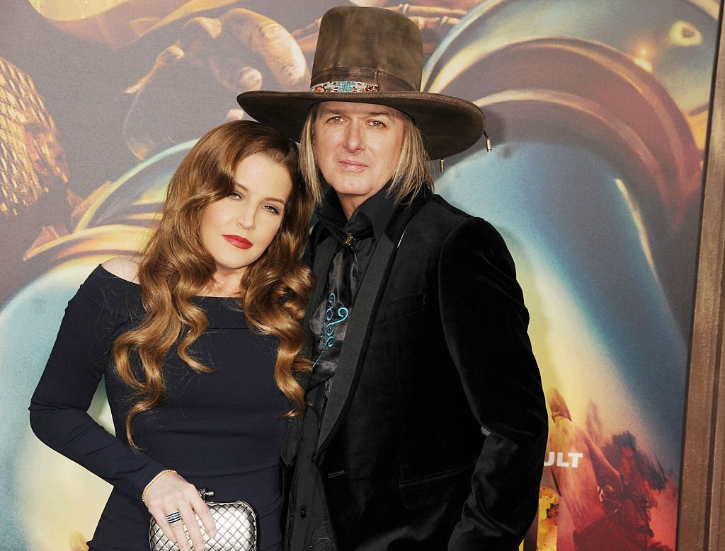 """Lisa Marie Presley and Michael Lockwood arrive at the """"Mad Max: Fury Road"""" Los Angeles Premiere at TCL Chinese Theater IMAX on May 7, 2015 in Hollywood, California 