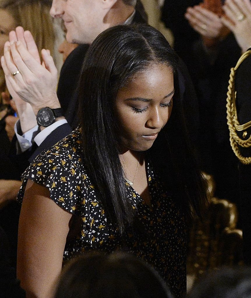 Sasha Obama leaves the State Dining room of the White House | Photo: Getty Images