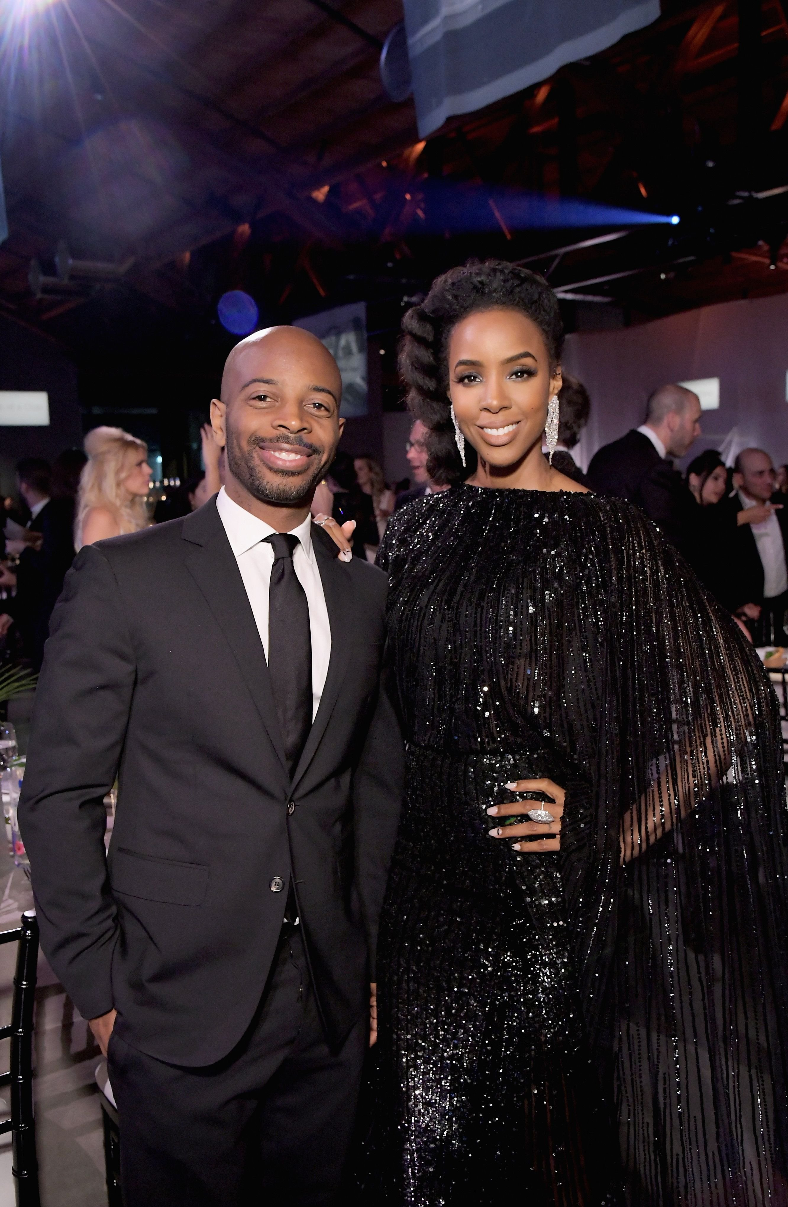 Tim Witherspoon and Kelly Rowland pose at the Baby2Baby Gala Presented by Paul Mitchell at 3LABS on November 10, 2018 in Culver City, California | Photo: Getty Images