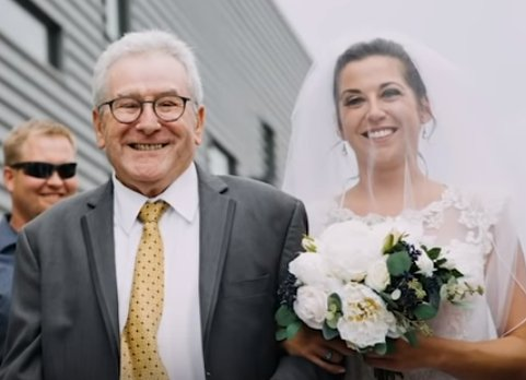 Jim Stamp with the bride, his daughter Gina. | Source: YouTube/GMA