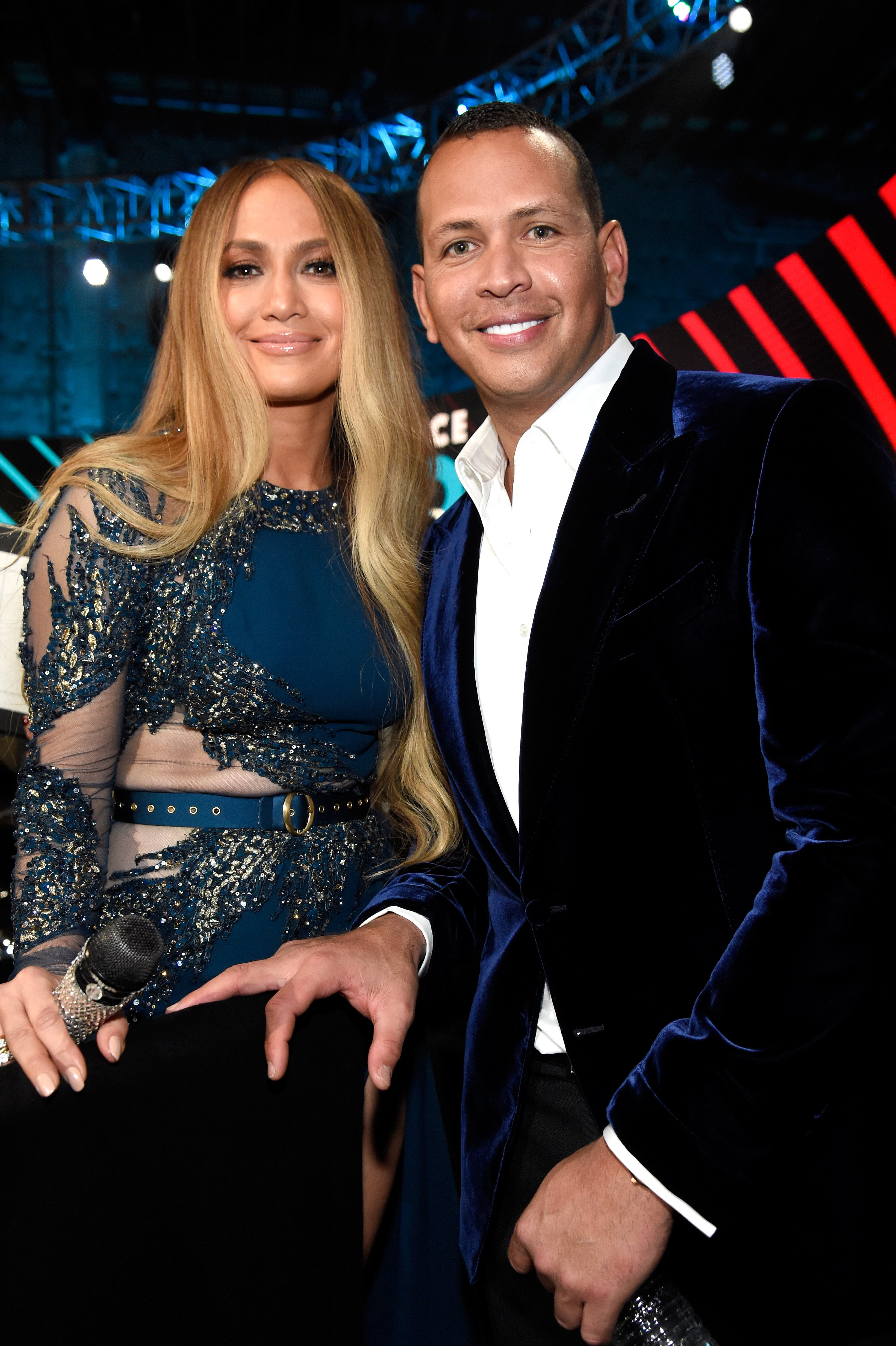 """Jennifer Lopez and Alex Rodriguez pose during """"One Voice: Somos Live! A Concert For Disaster Relief"""" at the Universal Studios. 