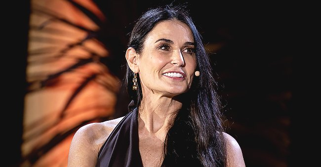 Demi Moore Defies Her Age Wearing Chic Glasses & a Black T-Shirt While Posing with a Sloth