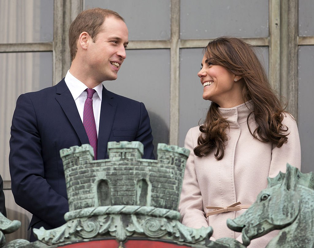 Prince William and Duchess Kate Middleton pictured on the balcony of The Guildhall during their first official visit to Cambridge, 2012, England.   Photo: Getty Images