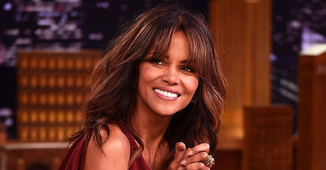 Halle Berry Displays Long Legs in a Flowy Dress While Doing a Last Minute Touch-up with a Razor