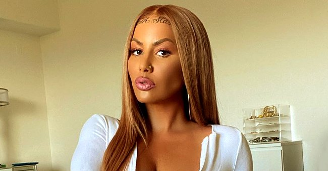 Kanye West's Ex Amber Rose Stuns with Long Blonde Wig and Body-Hugging White Outfit in a Photo