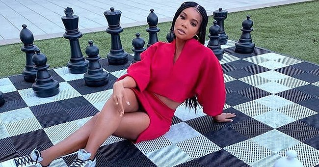 Gabrielle Union Poses in a Red Ensemble on a Huge Chess Board Inspired by 'The Queen's Gambit'