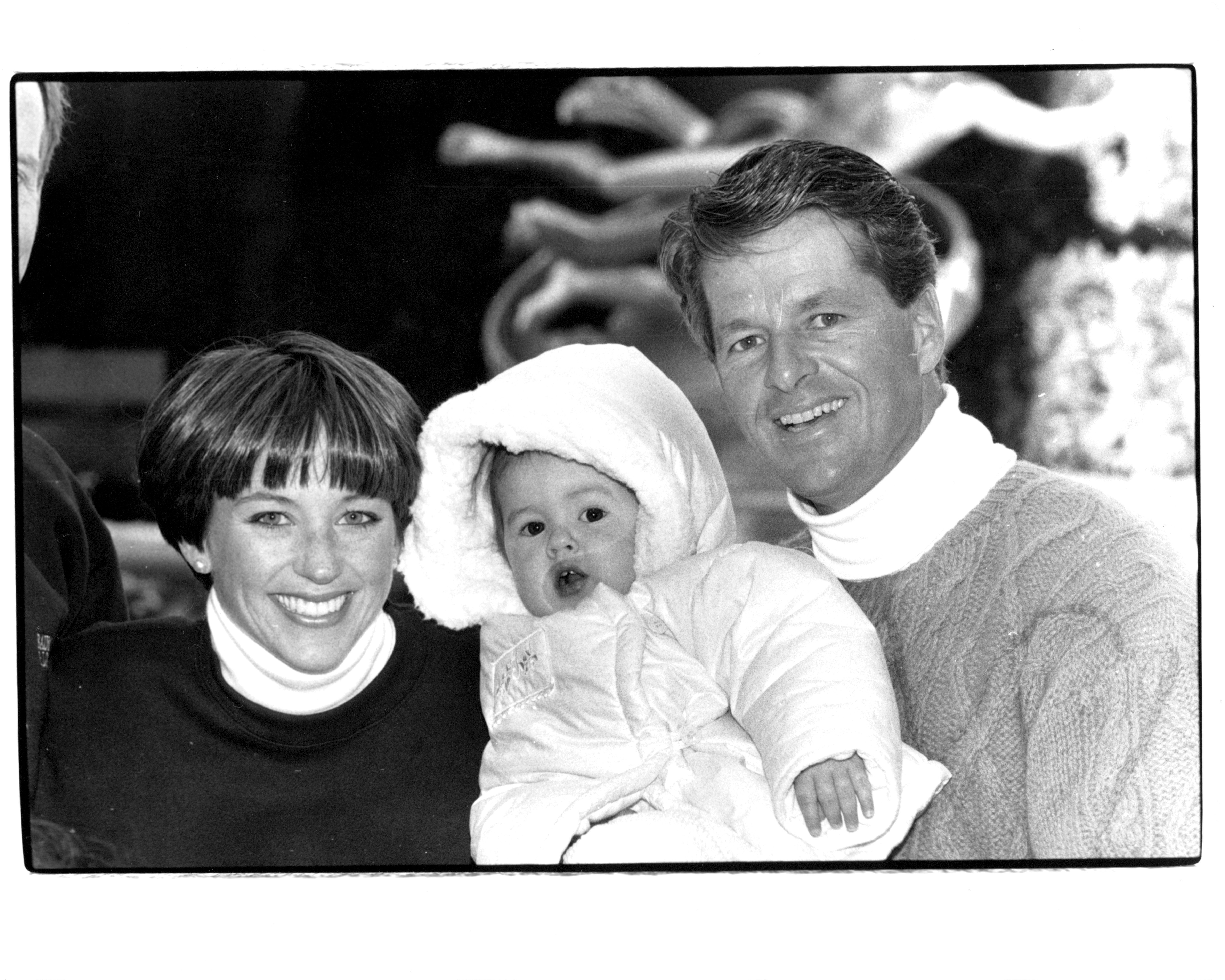 Dorothy Hamill, Husband Ken Forsythe and Daughter Alexandra in 1990 | Source: Getty Images