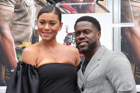 Kevin Hart and wife Eniko Parrish pose as Hart is honored with a Hand And Footprint Ceremony on December 10, 2019 | Photo: Getty Images