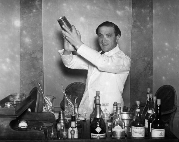 A barman on duty at the cocktail bar of Hector's Devonshire Restaurant preparing a cocktail.| Photo: Getty Images.