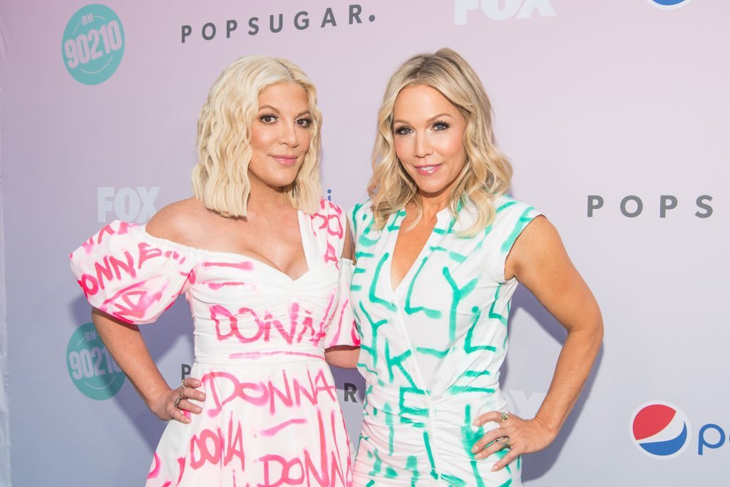 "Tori Spelling and Jennie Garth attend the ""Beverly Hills 90210"" Peach Pit Pop-Up in Los Angeles, California on August 3, 2019 