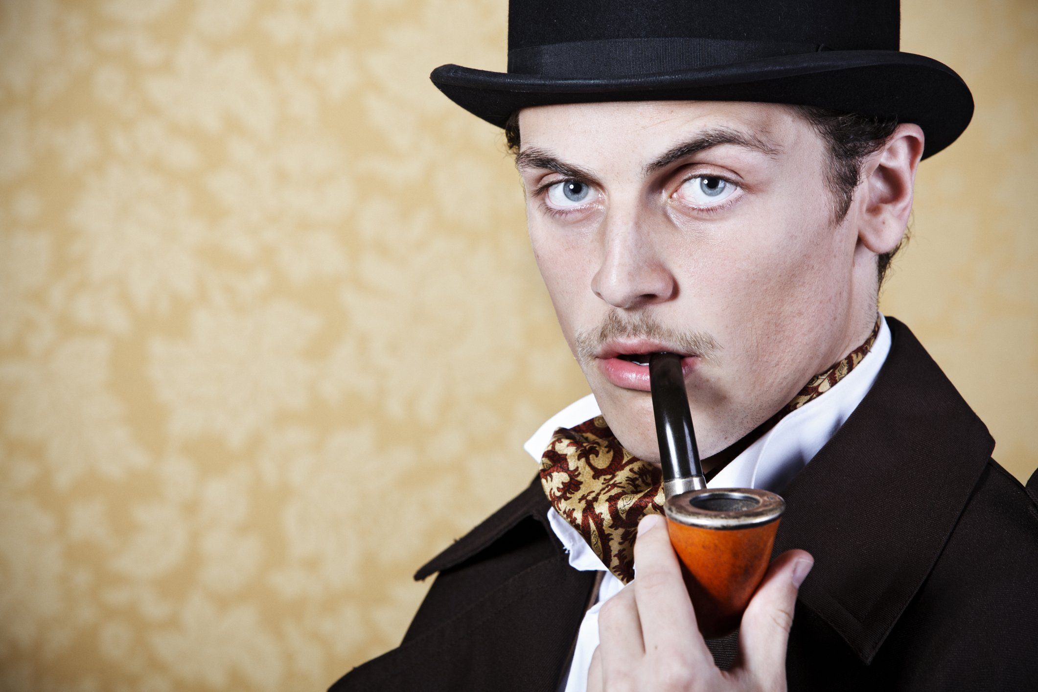 A man portraying Sherlock Holmes with pipe and hat.   Photo: Getty Images