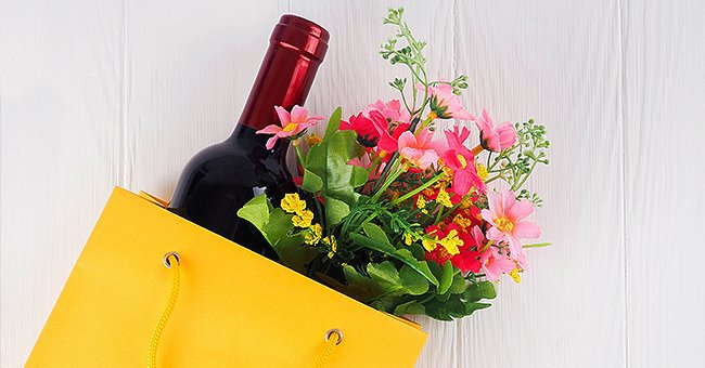Daily Joke: Man Approaches Cashier at Grocery Store with Two Bouquets and 2 Bottles of Wine