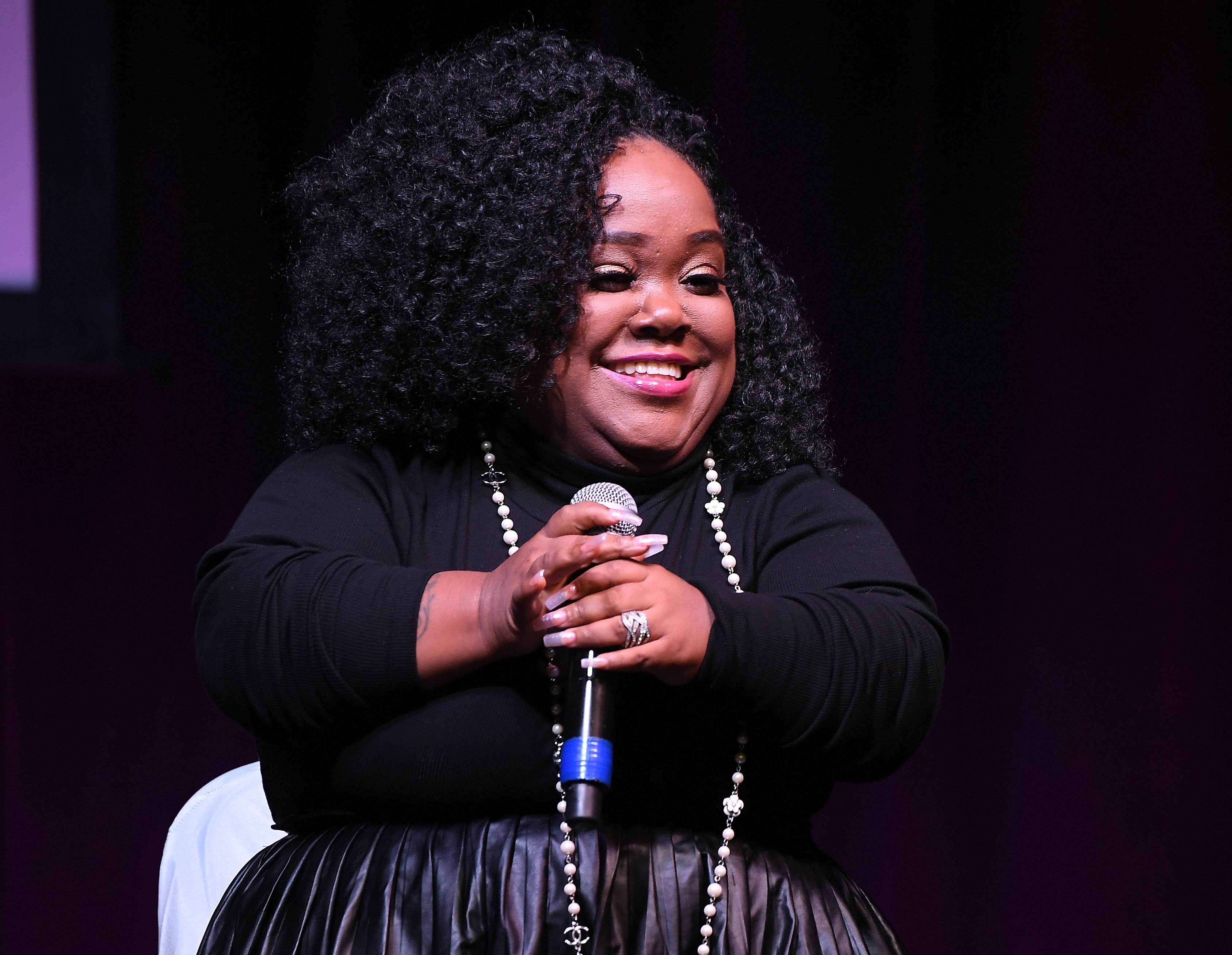 "Ashley ""Minnie"" Ross speaks onstage during 2019 Atlanta Ultimate Women's Expo on November 10, 2019, in Atlanta, Georgia. 