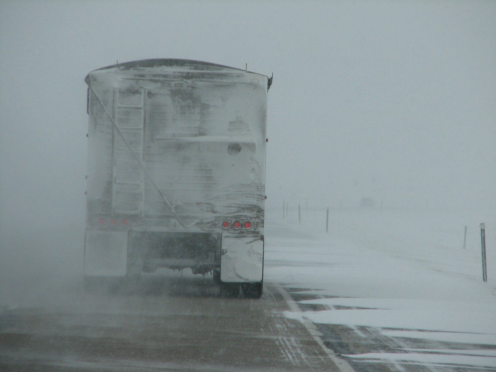 Pictured - A truck driving in the storm weather conditions | Source: Pixabay