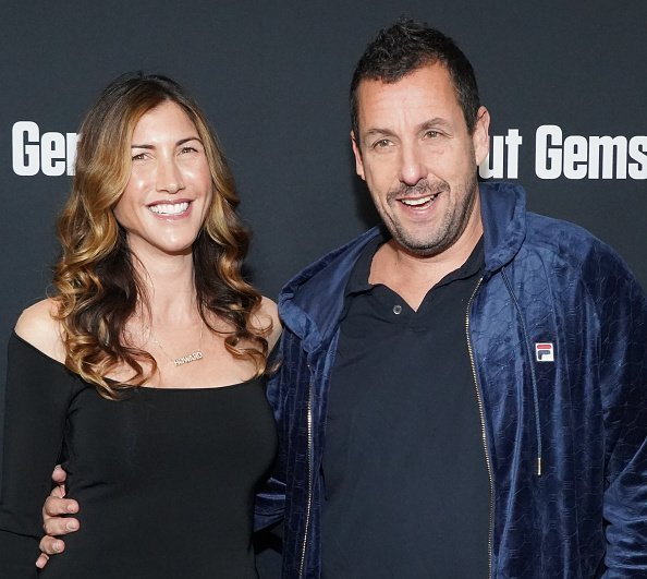 """Adam Sandler and Jackie Sandler at the premiere of A24's """"Uncut Gems"""" on December 11, 2019 